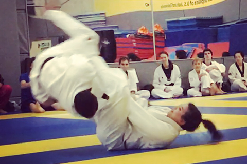 image of Elaine performing a flying armbar